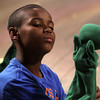 "Allegra Boverman/Staff photographer. Gloucester Daily Times. Gloucester: Roxie Myhrum, artistic director of the Puppet Showplace Theatre of Brookline, gave a puppeteering workshop at the Gloucester Stage Company's Youth Acting Workshops on Friday. She also coached the actors in the GSC's current production of ""Carnival."" Brandon Bruce, 11, learns how to make his puppet come alive."