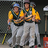 Beverly: Manchester player rush onto the field to celebrate a home run by Harry Painter during their game against Gloucester at Harry Ball Field in Beverly. Jim Vaiknoras/staff photo