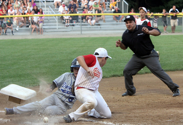 ALLEGRA BOVERMAN/Staff photo. Gloucester Daily Times. Beverly: Sal Costanzo, at third base for Gloucester American, tussles with Danvers American player Tim Usalis during their game in Beverly on Friday night.<br /> <br /> during their game in Beverly on Friday evening.