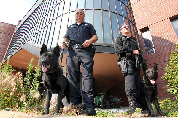 ALLEGRA BOVERMAN/Staff photo. Gloucester Daily Times. Gloucester: Trident, lower left, is the latest addition to the Gloucester Police Department; his partner is Officer Jerry Ciolino. At right is Officer Chris Genovese and Mako.