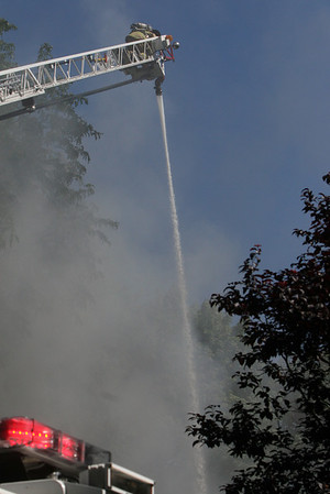 ALLEGRA BOVERMAN/Staff photo. Gloucester Daily Times. Gloucester: at Firefighters attacked the fire at 2 Ashland Place from above using the ladder truck Monday afternoon in Gloucester.