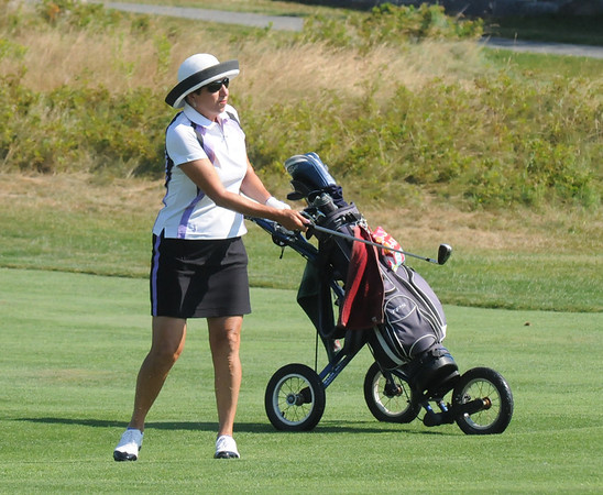Gloucester: Dusty Spiliotis hits her approach on the 1st hole at the Bass Rocks Club Championship Sunday morning. Jim vaiknoras/staff photo
