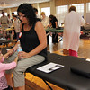 ALLEGRA BOVERMAN/Staff photo. Gloucester Daily Times. Gloucester: Allison Hammond, seated, sits upright and rests after giving blood on Thursday during a Red Cross blood drive in honor of her daughter Caleigh Harrison, who would have turned three on Friday. She is with her daughter, Lizzie, 5. The event was taking place at Gloucester House's Compass Rose Room.