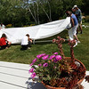 ALLEGRA BOVERMAN/Staff photo. Gloucester Daily Times.Rockport: Gretchen Anderson's 5 Witham Road garden on Thursday. Her gardens are on the Coastal Gardens tour on Friday and Satuday in Rockport. A luncheon and art sale will be held at her home's grounds as well, and members of the Garden Club were setting up tents and shelters on Thursday.