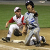 ALLEGRA BOVERMAN/Staff photo. Gloucester Daily Times. Beverly: Danvers player Jackson Leete, right, protests being tagged out at third base by Gloucester American player Evan Leaf, left, during their game in Beverly on Friday evening.