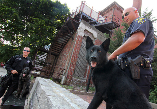 ALLEGRA BOVERMAN/Staff photo. Gloucester Daily Times. Gloucester: Trident, right, is the latest addition to the Gloucester Police Department; his partner is Officer Jerry Ciolino, far right. At left are Officer Chris Genovese and Mako.