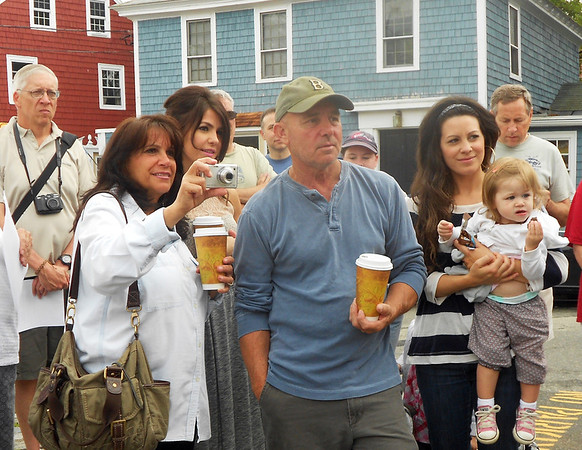 Gail McCarthy/Staff photographer. Gloucester Daily Times. Rockport: A family of history buffs here on vacation attended the reading of the  Declaration of Independence on July 4 in Rockport. Diane and Bob Mogan, who now reside in Tennessee, used to live in Annisquam and had a shop onBearskin Neck. They are standing with their two daughters, Genevieve Braun, 30, and her sister, Rebecca Mogan, 29. The third generation of the family is represented by Braun's two daughters, Evangeline, 4, and 18-month old Cecily.