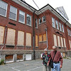 ALLEGRA BOVERMAN/Staff photo. Gloucester Daily Times. Gloucester: Ida and John Christopher of 122 Maplewood Avenue, who live right next door to the old Maplewood School, walk around the premises on Friday afternoon and talk about what it was like when children attended school there. They lived next door for decades and their children went to the school.