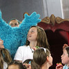"Allegra Boverman/Staff photographer. Gloucester Daily Times. Gloucester: Roxie Myhrum, artistic director of the Puppet Showplace Theatre of Brookline, top, with her puppet, Bartok, gave a puppeteering workshop at the Gloucester Stage Company's Youth Acting Workshops on Friday. From left: Miranda Joyce  and Elaina Turner, both 11, react to Bartok while they sing ""Row, Row, Row Your Boat."""
