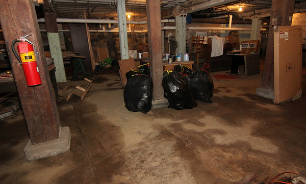 ALLEGRA BOVERMAN/Staff photo. Gloucester Daily Times. Essex: The basement of the Essex Town Hall is very damp. The floors show where there is moisture, and often there is standing water there.