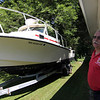 ALLEGRA BOVERMAN/Staff photo. Gloucester Daily Times. Gloucester: Miles Schlichte, deputy fire chief and liasion to the city of Gloucester for the Citizens Emergency Response Team, talks about the fire boat that CERT will use that was donated by the New Bedford fire department. The boat is 25 feet long, has a fire pump, a dive platform and a dive door, and has a full set of electronics.