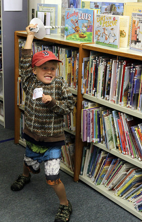 MARIA UMINSKI/GLOUCESTER DAILY TIMES 5 year-old Doron Appleyard of Essex gets ready to strike in the middle of a sword fight during the Pirate Festival at TOHP Burnham Library in Essex.
