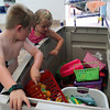 MARIA UMINSKI/GLOUCESTER DAILY TIMES Siblings Jack and Charlotte Nicastro, 5 and 4 respectively, search for toys to play with in the pool at the Gloucester YMCA. The Y opened the pool to the public, for free, on Wednesday as a way for residents to beat the summer heat.