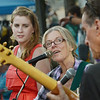 """MIKE SPRINGER/Gloucester Daily Times<br /> Janice Fullman, center, of Manchester sings with her group """"A Little Bit Country"""" along with bandmates Kaleight Knudsen of Ipswich, left, and Marty Brien of Cambridge during the first downtown block party of the season Saturday evening on Main Street in Gloucester. The event included outdoor dining, entertainment, dancing, games and other activities."""