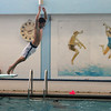 MARIA UMINSKI/GLOUCESTER DAILY TIMES Ignazio Locontro, 9 of Gloucester, launches off the diving board at the Glocuester YMCA on Wednesday. The Y opened the pool to the public, for free, on Wednesday as a way for residents to beat the summer heat.