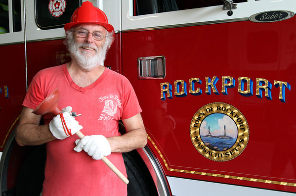 MARIA UMINSKI/GLOUCESTER DAILY TIMES George Ramsden stands infront of a Rockport firetruck decked out in his annual parade outfit. Ramsden is ending his 50 year run of leading the annual Rockport fireman band and fouth parade this weekend.