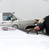 MARIA UMINSKI/GLOUCESTER DAILY TIMES Lt. John McCarthy takes a look at the Wounded Warrior Porject seal on the hood of the revamped police hum-vee. The hum-vee was redone in honor of the veterans and will be a part of the horribles parade this weekend.