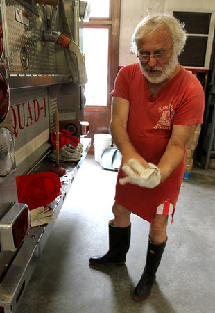 MARIA UMINSKI/GLOUCESTER DAILY TIMES George Ramsden puts on his parade gear in the Rockport Firestation. Ramsden is ending his 50 year run of leading the Rockport fireman band and fouth parade.