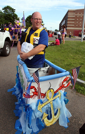 MARIA UMINSKI/GLOUCESTER DAILY TIMES Larry Fogarty of Glosta Joes's Coffee waits patiently for the Fishtown Horribles Parade to start in his make-shift lobster boat, coffee samples in hand.