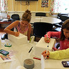MARIAUMINSKI/GLOUCESTER DAILY TIMES From left to right, Karoline Sucic, 13, Sarah Murphy, 13, Colleen Murphy, 12, and Angelina Jimenez 11, all of Rockport, use their iPhones to pull up pictures to help them design their Andy Warhol inspired art projects during the Art Blast program at the Rockport Community House.