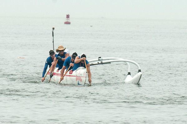 """DESI SMITH/Staff photo. The Florida crew of the """"OC6"""" outrigger digs deep as they head for the finish at Pavilion Beach in the Blackburn Challenge, Saturday morning.    July 19,2014"""