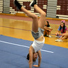 RYAN HUTTON/ Staff photo.<br /> Lauren Movalli, 11, practices a backflip at cheerleading camp in the Gloucester High School field house on Tuesday.