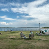DESI SMITH/Staff photo.   People relax along the boulevard and watch boats pass by, saturday afternoon.  July 26,2014