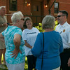 DESI SMITH/Staff photo.  Gloucester Fire Cheif Eric Smith talks to some happy Magnolia residents, at a reopening and reception held Saturday morning at the station in Magnolia.<br />   July 5,2014