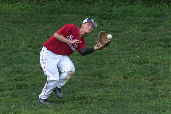 DESI SMITH/Staff photo.  Rockport's right fielder #14 make a catch against Manchester Friday night at Evans Field in Rockport.  July 25,2014