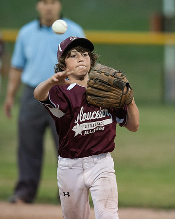 DESI SMITH/Staff photo.    Gloucester National's second basemen Nicholas Beck fieilds a ground ball and throws to first against M/E in a Little League game held at Boudreau Field Wednesday night.<br />   July 2,2014