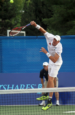 MARIA UMINSKI/GLOUCESTER DAILY TIMES John Isner of the Boston Lobsters serves the ball to Frank Dancevic of the Philadelphia Freedoms during their match at the Manchester Athletic Club.
