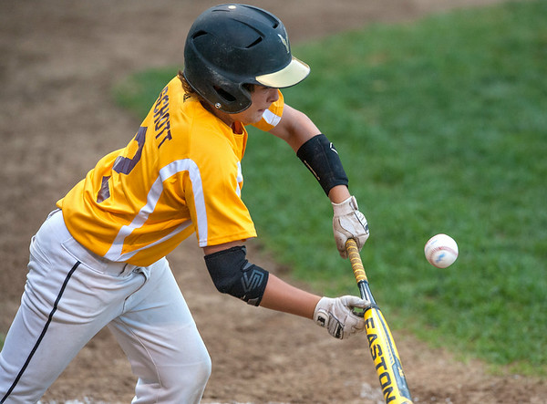 DESI SMITH/Staff photo.    Gloucester's Noah Schott lays down a bunt against Hamilton/Wenham in the Williamsport Little League Playoffs Saturday evening at Harry Ball Field in Beverly.<br />   July 5,2014
