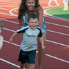 DESI SMITH/Staff photo.  Annmarie Cody Oliveira helps her son Cameron Oliveira 3, of Gloucester, as he competes in the 50 yard dash at the annual youth track meet Wednesday afternoon at Newell Stadium.<br />   July 9,2014