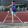 DESI SMITH/Staff photo.  Katie Fernandes 9, of Gloucester, competes in the long jump at the annual youth track meet Wednesday afternoon at Newell Stadium.<br />   July 9,2014
