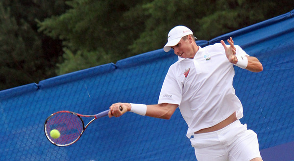 MARIA UMINSKI/GLOUCESTER DAILY TIMES John Isner of the Boston Lobsters sends the ball back over the net during his match with Frank Dancevic of the Philadelphia Freedoms at the Manchester Athletic Club.