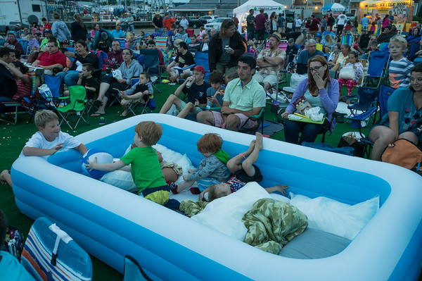 """DESI SMITH/Staff photo.   The Franklin family of Gloucester brought a inflatable pool, with blankets and pillows for their outing at the outdoor movie showing of """"Back to the Future"""" on I-4 C-2 property Wednesday night, as part of city-sponsored Summer Cinema Series.  July 23,2014"""