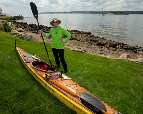 RYAN HUTTON/ Staff photo.<br /> Deborah Walters poses with her kayak at Wonson's Cove after stopping on her trip from Maine to Guatemala to benefit the non-profit Safe Passage that helps children living in and around Guatemala City's garbage dump.