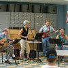 DESI SMITH/Staff photo.   From left to right, Dr. Richard Safier, GHS Transition Coordinator Nancy Goodman, GHS Principal Erik Anderson, and Elementary Music Teacher Helen Greene, practice in the music room at the Gloucester High School Saturday morning. The group performed on the Beauport Princess Sunday night, for a fundraiser for the Gloucester Education Fund.  July 26,2014