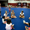 RYAN HUTTON/ Staff photo.<br /> Hayden Koller, 5, chases instructor Bailey Titus, 16, in a game of duck, duck, goose at cheerleading camp in the Gloucester High School field house on Tuesday.