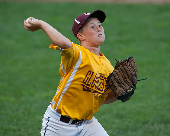 DESI SMITH/Staff photo.    Gloucester's Zack Abbott throws to first on the play against Hamilton/Wenham in the Williamsport Little League Playoffs Saturday evening at Harry Ball Field in Beverly.<br />   July 5,2014