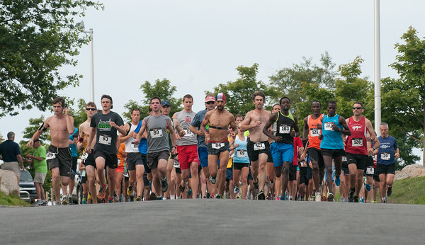 DESI SMITH/Staff photo.  Runners take off in the Seacoast 7k Saturday morning. The race started and finished at Stage Fort Park.     July 19,2014