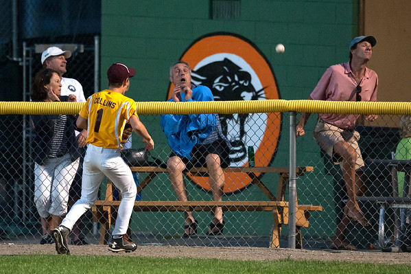 DESI SMITH/Staff photo.   Spectators react to a home run ball hit by Hamilton/Wenham's Will Franias it sails over the fence, as Gloucester's center fielder, Even Collins has no chance on the play, in the Williamsport Little League Playoffs Saturday evening at Harry Ball Field in Beverly.<br />   July 5,2014