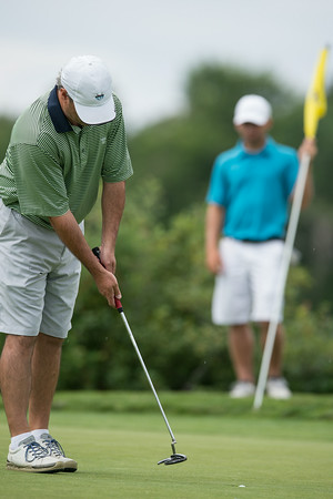 DESI SMITH/Staff photo. Last years defending champ, Ed Young sinks a putt during the 2014 Club Championship playoffs Sunday morning at Bass Rocks Golf Club.    July 20,2014