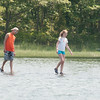 DESI SMITH/Staff photo.  Brad Johnson 19, and Hannah Lamoureaux 12, of Georgetown, appear to be walking on water, as they walk back over some rocks that got covered by the rising tide Sunday afternoon, just past exit 13 north bound, heading to Gloucester. July 13,2014