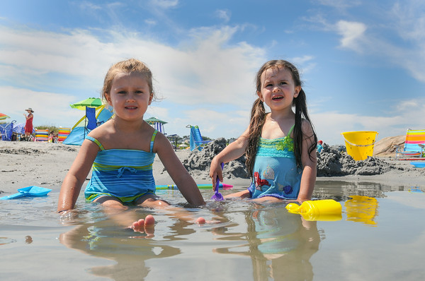 DESI SMITH/Staff photo.  Brielle Stone 5, (left) and sister Taegan 3 of Freehold, NJ, have their own place on the beach to cool off and have some fun at Wingaersheek Beach Saturday afternoon in Gloucester. The girls come to visit their grand parents Terri and Kevin Mulhern of Gloucester.  July 12,2014