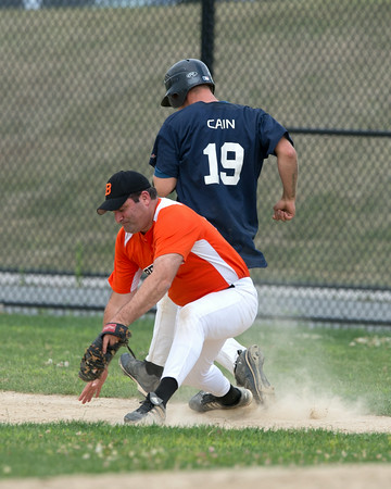 DESI SMITH/Staff photo.   Manchester/Essex's Mike Cain can't beat the throw to first against Beverly Sunday afternoon at Cooney Field in Beverly.