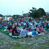 "DESI SMITH/Staff photo.   Locals set up their spots on some artificial grass, with chairs, blankets and pillows for their outing at the outdoor movie showing of ""Back to the Future"" on I-4 C-2 property Wednesday night, as part of city-sponsored Summer Cinema Series.  July 23,2014"