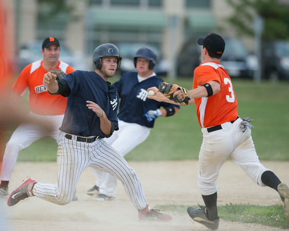 DESI SMITH/Staff photo.   Manchester/Essex's Dylan Maki gets caught in a run down and is taged out against Beverly Sunday afternoon at Cooney Field in Beverly.