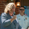 DESI SMITH/Staff photo.  Gloucester Fire Cheif Eric Smith listens, as Mayor Carolyn Kirk talked about how important it was to reopen the Magnolia fire station,and thanked the city counselors and everyone involed at a reception held Saturday morning at the station in Magnolia.<br />   July 5,2014