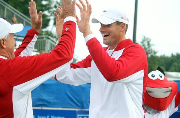 MARIA UMINSKI/GLOUCESTER DAILY TIMES John Isner high-fives Coach Robert Greene before the Boston Lobster's match against the Philadelphia Freedoms at the Manchester Athletic Club.
